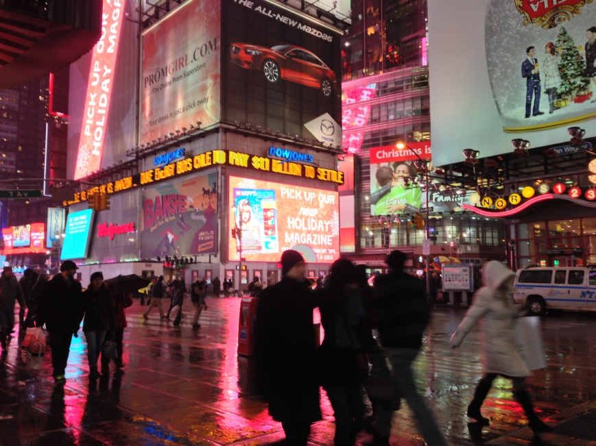 Intersection of 7th Avenue and West 42nd Street. New York, NY. Wednesday, December 26, 2012, 7:44 PM EST.