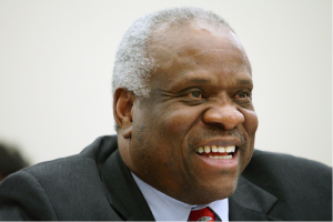 The jovial man. (Picture via: http://www.article-3.com/wp-content/uploads/2013/01/Justice-Thomas.jpg.)